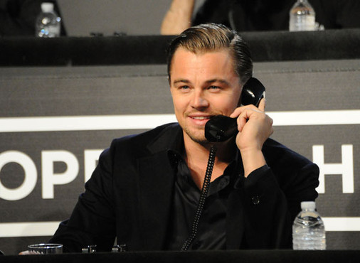 image of Leonardo Di Caprio speaking on a black hand set phone