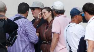 Marion Cotillard talks to the crew between scenes