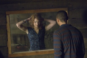 Kristen Connolly and Jesse Williams discover something funny with the mirror