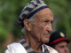 Ed Mosberg wearing the Tallit in Birkenau whilst listening to the Hatikva