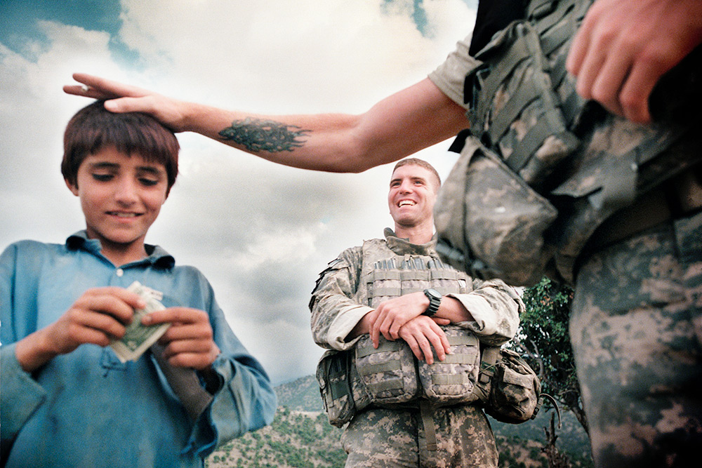 The Land of the Enlightened US army soldier's and Afghan boy