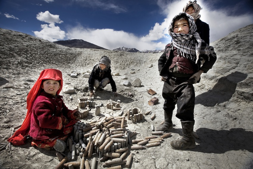 The Land of the Enlightened Afghan children with old amunition